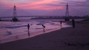 MATARA, SRI LANKA - MARCH 2014: View of people in front of suspension bridge linking pigeon island to Matara. stock footage