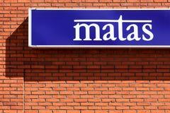 Matas tecken på en vägg Arkivbild