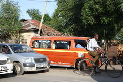 Matatu, cyclist. Mombasa. Royalty Free Stock Images