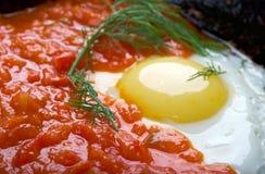 Matbucha and scrambled eggs Stock Photo