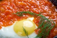 Matbucha and scrambled eggs Royalty Free Stock Photography