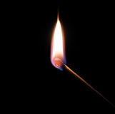 Match. Bursting into flame against a black background Royalty Free Stock Image