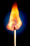 Match. Igniting match, focus on it's topping Royalty Free Stock Photography
