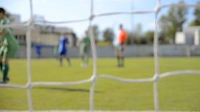 Match av ett ungdomfotbolllag arkivfilmer