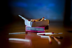 Match box and match sticks lying on floor Royalty Free Stock Images