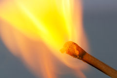 Match bursting to flame close up Royalty Free Stock Image