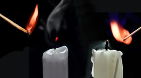 Match and candle. On a black Royalty Free Stock Image