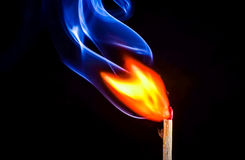 A match catching fire and burning Royalty Free Stock Image