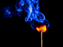 A match catching fire and burning Stock Image