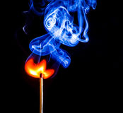 A match catching fire and burning Stock Photos