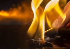 Match fire hand. To hold a match in the hand and a bright fire Royalty Free Stock Photos