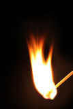 Match flame on black background. Royalty Free Stock Photos