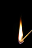 Match flame on black background. Royalty Free Stock Photo