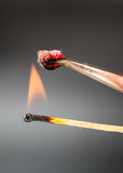Match flame ignites silk fabric sample Royalty Free Stock Images