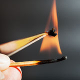 Match flame ignites synthetic tissue sample Stock Image