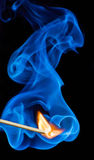 Match flame and smoke. Royalty Free Stock Images