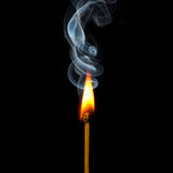 Match in flame and smoke Royalty Free Stock Photo
