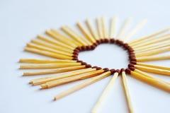 Match folded into shape of a heart. Match folded into the shape of a heart stock images