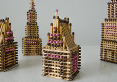 Match houses. Houses made of brown and pink matches Stock Photos