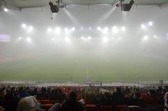 Match i dimman Arkivbild