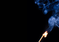 Match ignition. With smoke over black background Stock Image