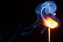 Match. Ignition of match with smoke Royalty Free Stock Image