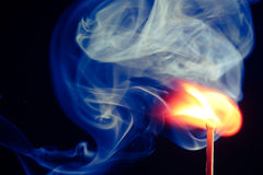 Match. Ignition of match with smoke Stock Image