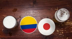 Match-Kalender des Weltcup-2018, Bier Mats Concept Flyer Background Kolumbien GEGEN Japan stockbilder