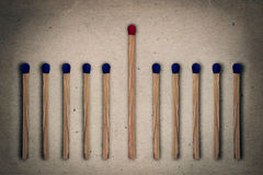 Match leadership. Red match standing middle a row of blue ones. Standing out from the crowd, leadership, difference concept Stock Photo