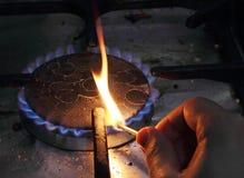 Match lighting stove Stock Photo