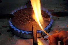 Match lighting stove Stock Photography