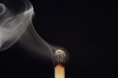 Match med rök efter brand Arkivbilder