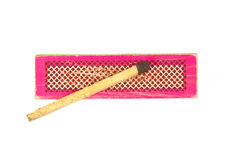 Match on an old and used red or pink box isolated Stock Photos