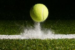 Match point. With a tennis ball hitting the line stock images