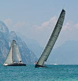 Match race. Team Beecom, Isao Mita / Kelvin Harrap - SLAM sailing gear Team Magia-Carbon Michel Vaucher From 9th - 13th July the Malcesine SLAM CUP italy royalty free stock images