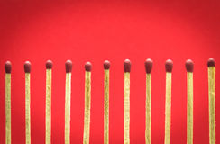 Match setting on red background for ideas and inspiration Royalty Free Stock Photo