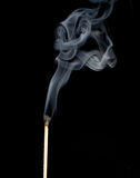 Match in the smoke Royalty Free Stock Photo