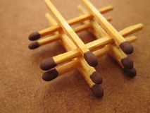 A Stack of Matches. Match sticks arranged in a square like stack on a brown surface royalty free stock photos