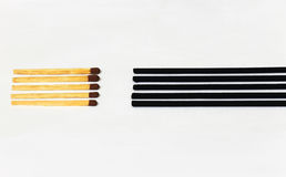 Match sticks facing incense sticks Royalty Free Stock Images