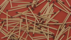 Match sticks on a red background. stock video footage