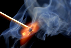 Match strike and smoke. Match stick struck with flames and smoke Royalty Free Stock Photos