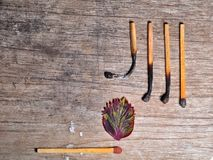 Match with a strip leaf and Different stages of match burning. Burnt matches isolated on wooden background. Creative background. Fire safety concept stock images