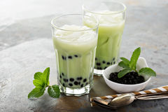 Matcha bubble tea. With tapioca pearls in tall glasses Stock Photos