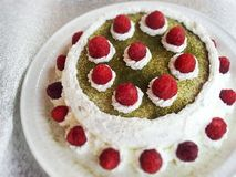 Matcha cake. With raspberry and whipped cream Stock Photo