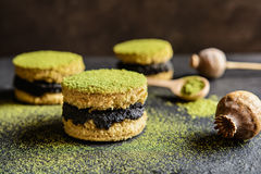 Matcha cakes with poppy seeds. Matcha green tea cakes with poppy seeds filling royalty free stock image