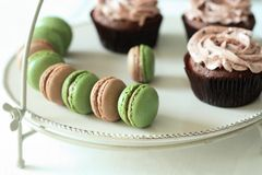 Matcha cocoa macarons. This is matcha cocoa macarons and cup cake,delicious teatime Stock Photography