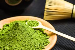 Matcha green powder and bamboo tea whisk Stock Photography