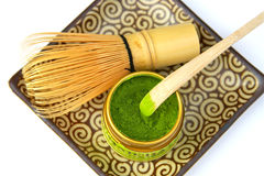 Matcha Green Tea. Powder with a bamboo whisk and scoop as used in a traditional Japanese tea ceremony
