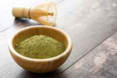 Matcha green tea in a bowl and bamboo whisk Royalty Free Stock Photography