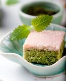Matcha green tea cakes with white chocolate glaze Stock Photo